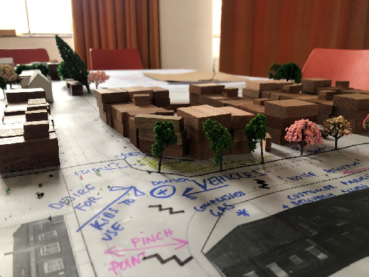 A model of the proposed plan, with comments written by attendees