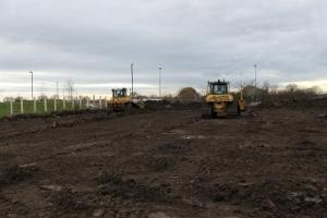 Bulldozers flatten the earth as work commences at York Community Stadium.