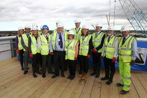 The building team stand together at the topping Out ceremony.